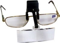 Magnifiers - attached to spectacles or with headband