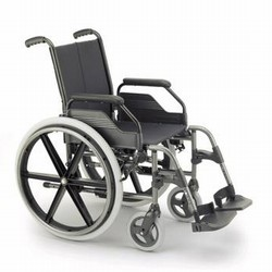 Self propelled wheelchairs with wheels set back
