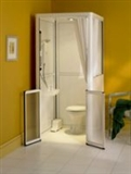 Ramped access corner shower cubicles