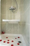 Hinged shower seats